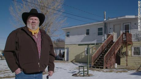 """Steve Gray stands outside his home in Gillette, Wyoming. After the election, he called CNN concerned that his city could become a """"ghost town."""" He says he was laid off from an oil field job in 2015, then subsequently from another job in oil and then one in coal last year."""