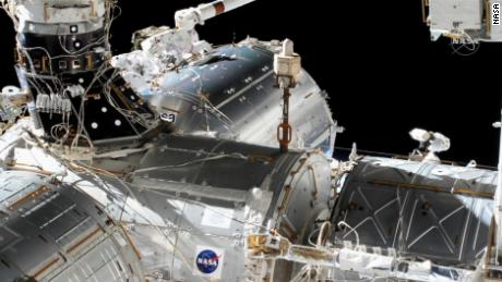 Hopkins and Glover work on the Columbus module.
