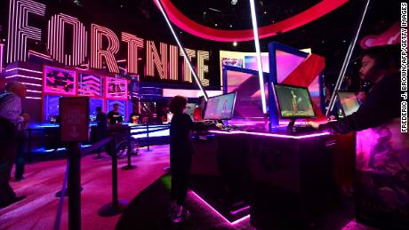 Gaming fans play Fortnite at the 2019 Electronic Entertainment Expo opening in Los Angeles, California on June 11, 2019.