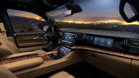 Grand Wagoneer interiors will include lots of wood and leather. Plus an available touchscreen for the front passenger.