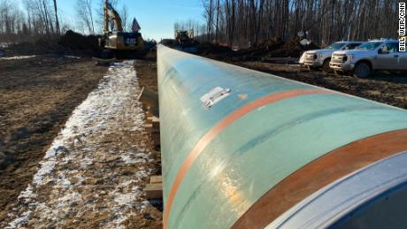 Pipe is laid for Line 3 through the northern Minnesota forests.