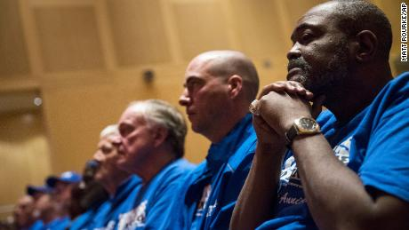 Death row exonerees including Kwame Ajamu, right, listens to speakers during a Witness to Innocence news conference marking the organization's 15th anniversary at the at the National Constitution Center in Philadelphia in 2018.