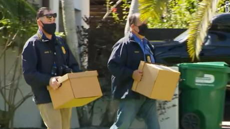 Police remove items from Artiles' home