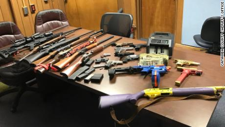 Police said they seized 20 weapons.