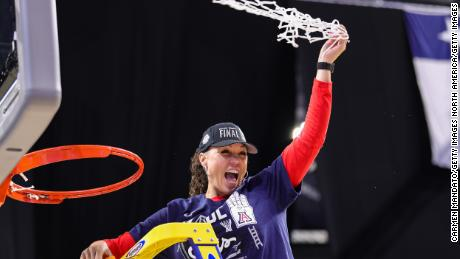 Arizona Wildcats head coach Adia Barnes of the Arizona Wildcats cuts the net after defeating the Indiana Hoosiers in the Elite Eight round of the NCAA Women's Basketball Tournamen.